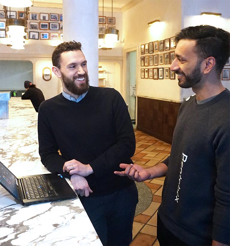 Photo of employee meeting with customer