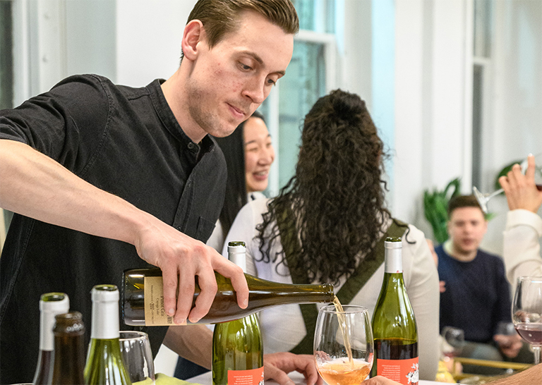 Photo of a gentleman pouring wine