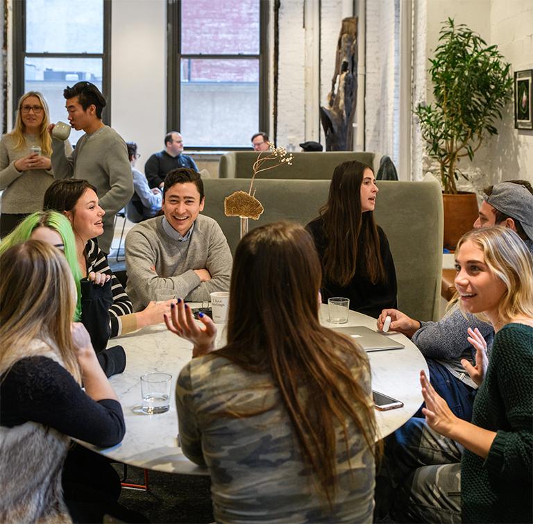 Photo of BentoBox team around a table